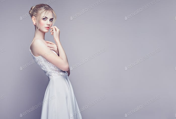 Thumbnail for Fashion portrait of beautiful young woman with blond hair