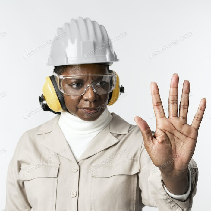 Civil engineer with safety glasses and earmuffs