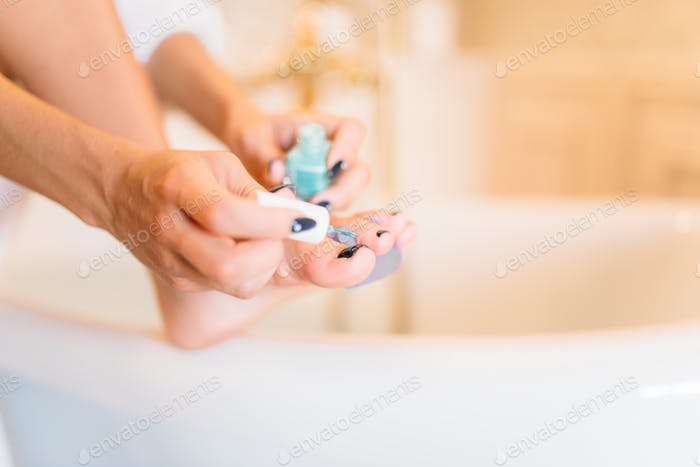 Female person hands with nail polish, pedicure