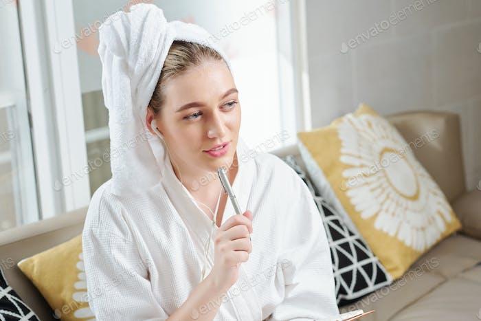 Woman feeling gratitude journal