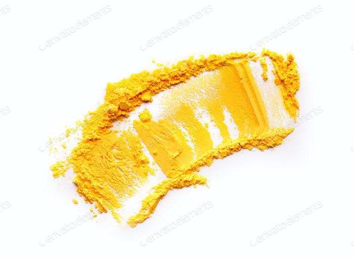 Yellow Holi powder smear on white background