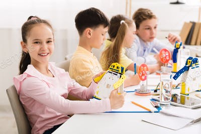 Stem education. Girl creating robot at lab
