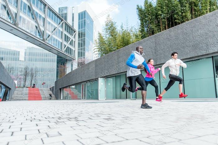 urban runners making sprints in an urban area