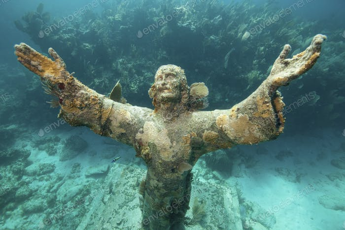 Arms raised heavenwards, the underwater Statue of Christ of the Abyss, Florida Keys National Marine