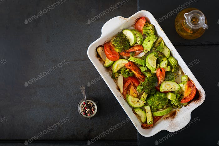 Stew of baked vegetables. Healthy food. Proper nutrition. Vegan dish. Flat lay. Top view