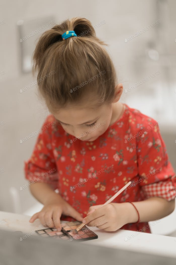 Child cosmetics Cute little girl