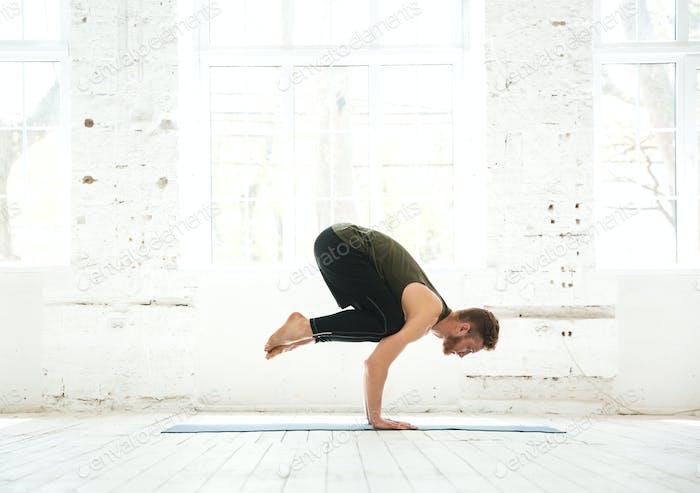 Man practicing advanced yoga