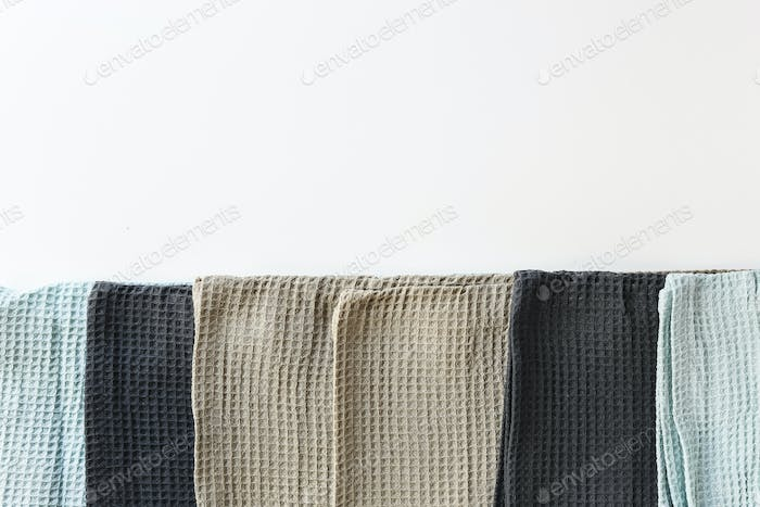Stack kitchen cotton towels on white background