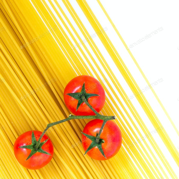 Uncooked spaghetti and cherry tomatoes