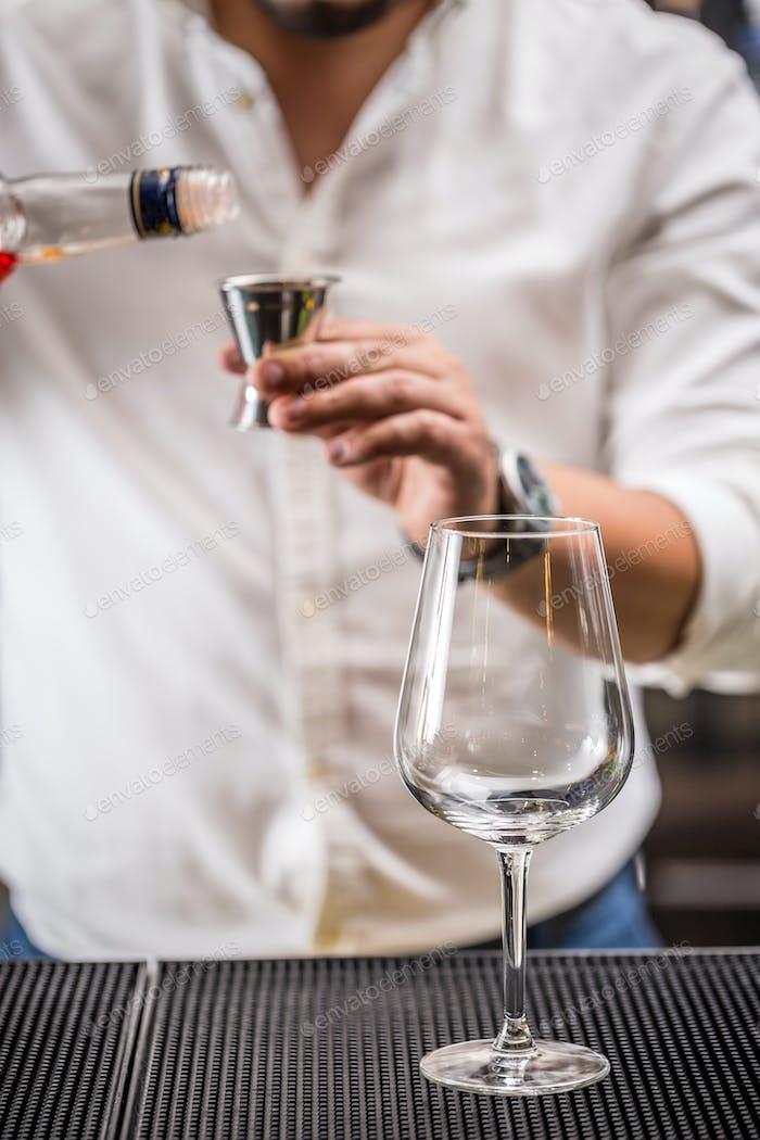 Bartender pouring liqueur