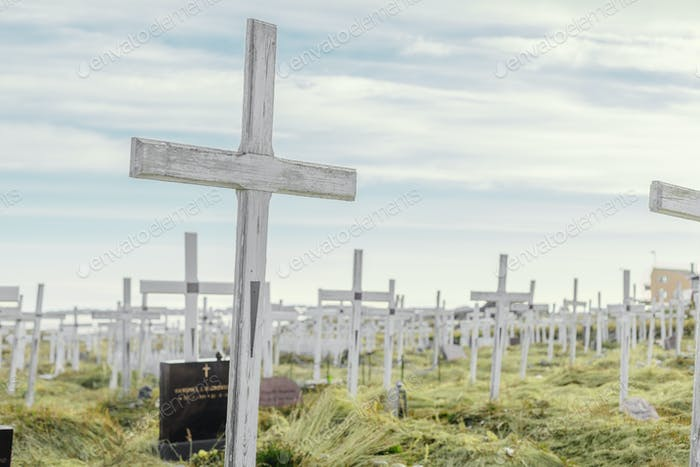 Crosses at cemetery against sky
