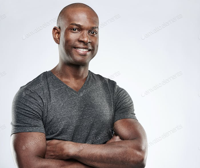 Man with folded muscular arms looking ahead