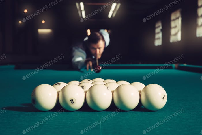 Man playing billiard