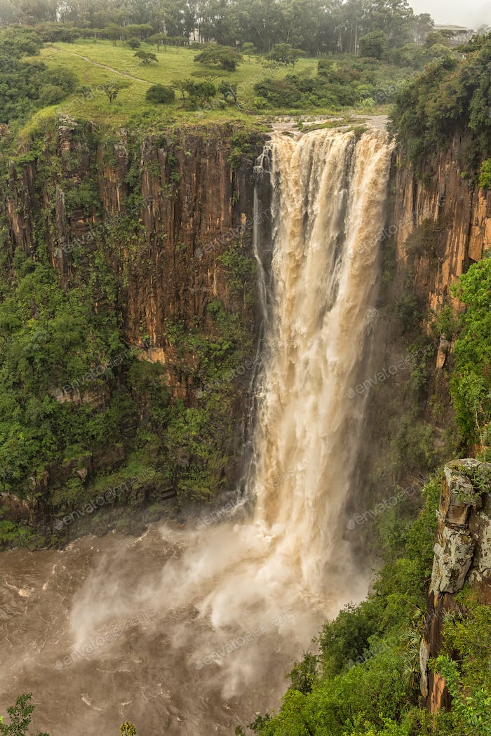 Flooded Umgeni River plunges 95 m down the Howick Falls