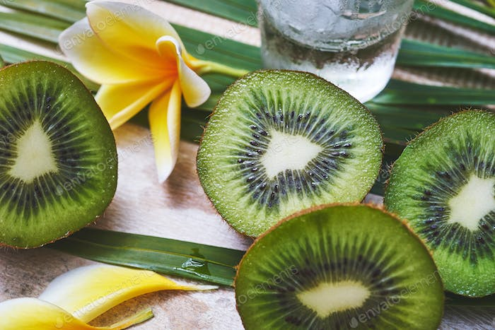 fresh tropical juicy kiwi slices on a wooden table