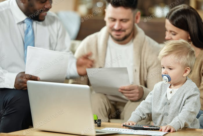 Family with charming boy on meeting with adviser