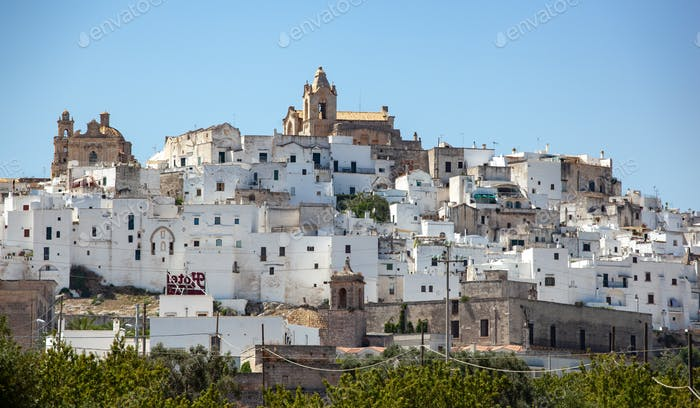 Panoramic view of the white and old city of Ostuni on a hilltop and with the cathedral on top