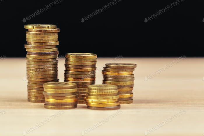 piles of coins on working table. creative photo