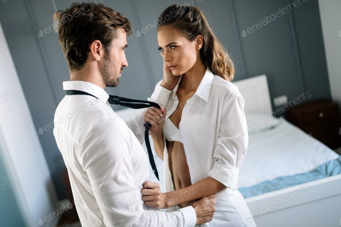 Sensual couple hug each other. Woman with glamorous face