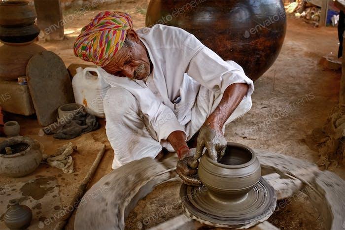 Indian potter at work, Shilpagram, Udaipur, Rajasthan, India