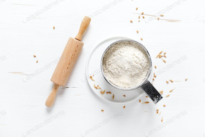 Flour on white kitchen worktop, baking culinary background, copy space, overhead view