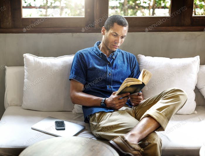 Attractive Young Man Reading Concept