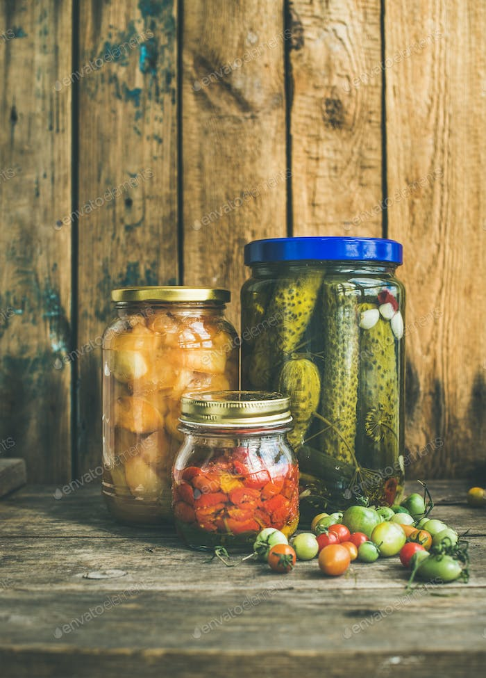 Autumn seasonal pickled vegetables and fruit in jars, copy space