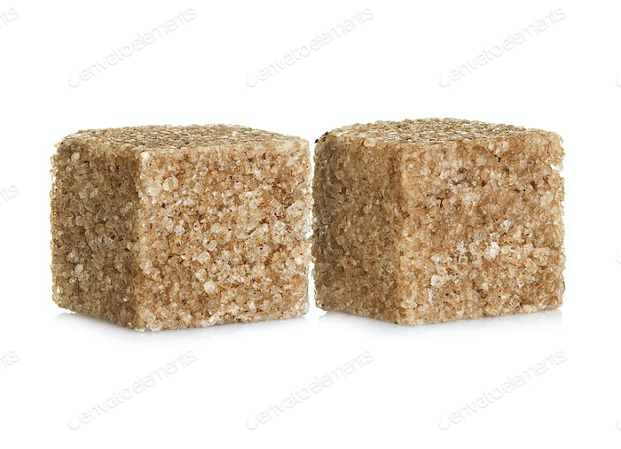 Brown sugar  cubes, isolated on white background