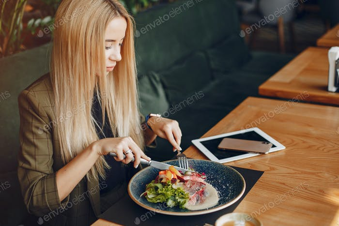 Elegant businesswoman sitting in a cafe