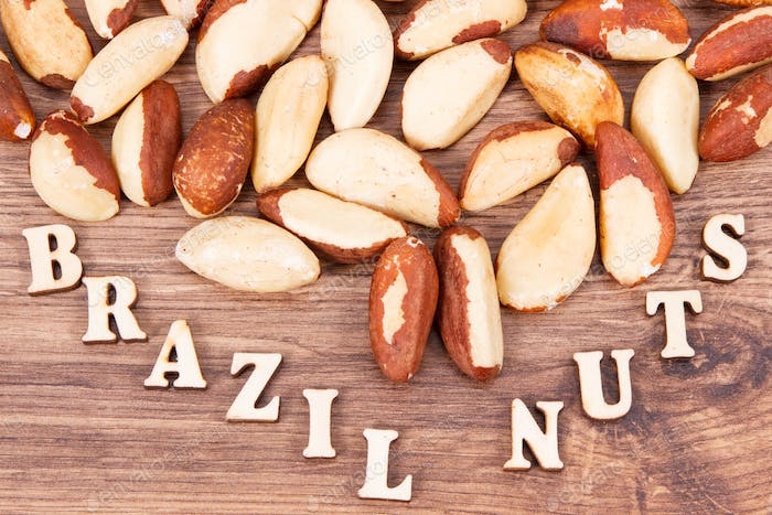 Inscription brazil nuts and fruits containing natural minerals and vitamin