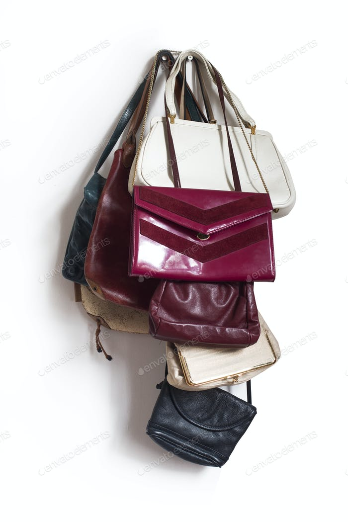 many vintage woman handbags