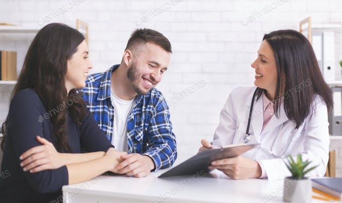 Cheerful doctor showing good analysis results to happy man