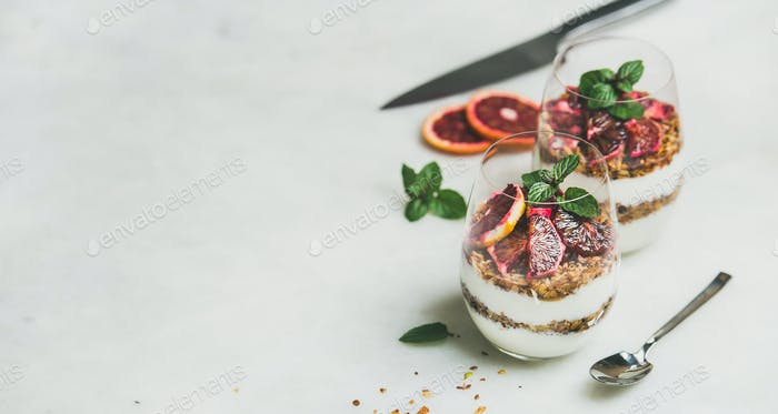 Healthy breakfast with greek yogurt, granola, blood orange layered parfait