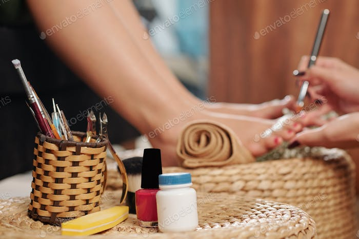Wicker holder with pedicure tools