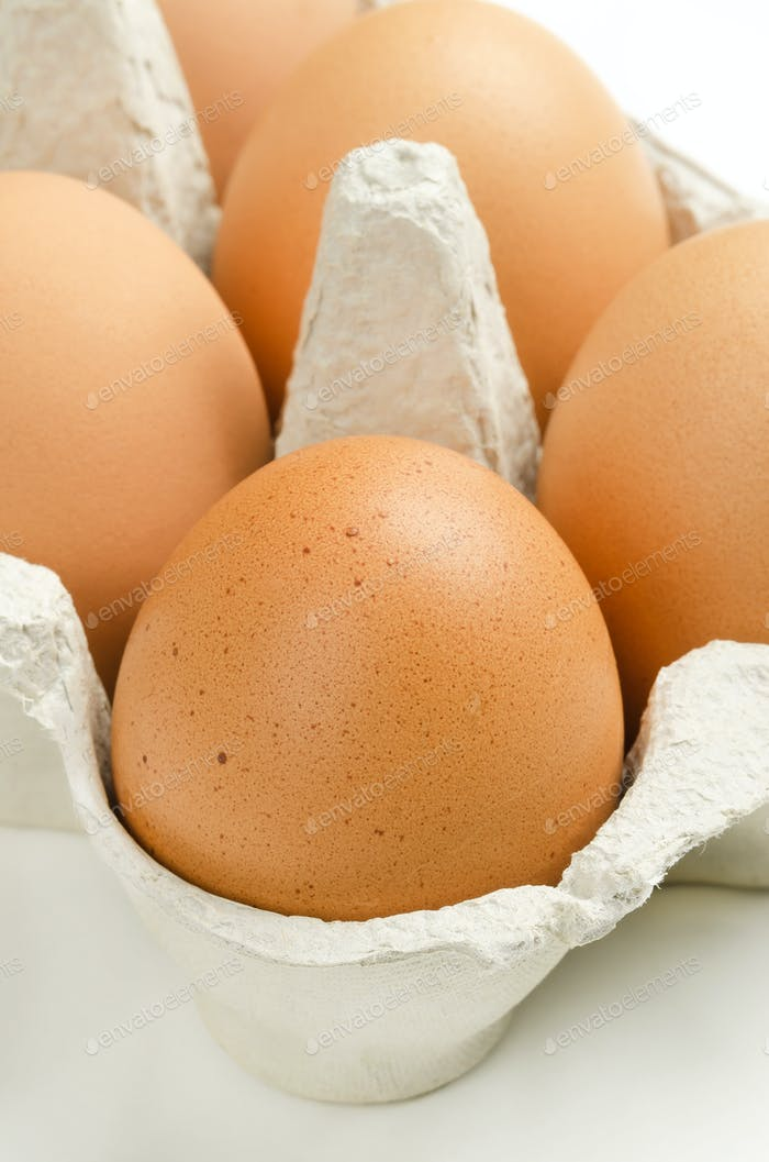 Brown chicken eggs in gray egg carton