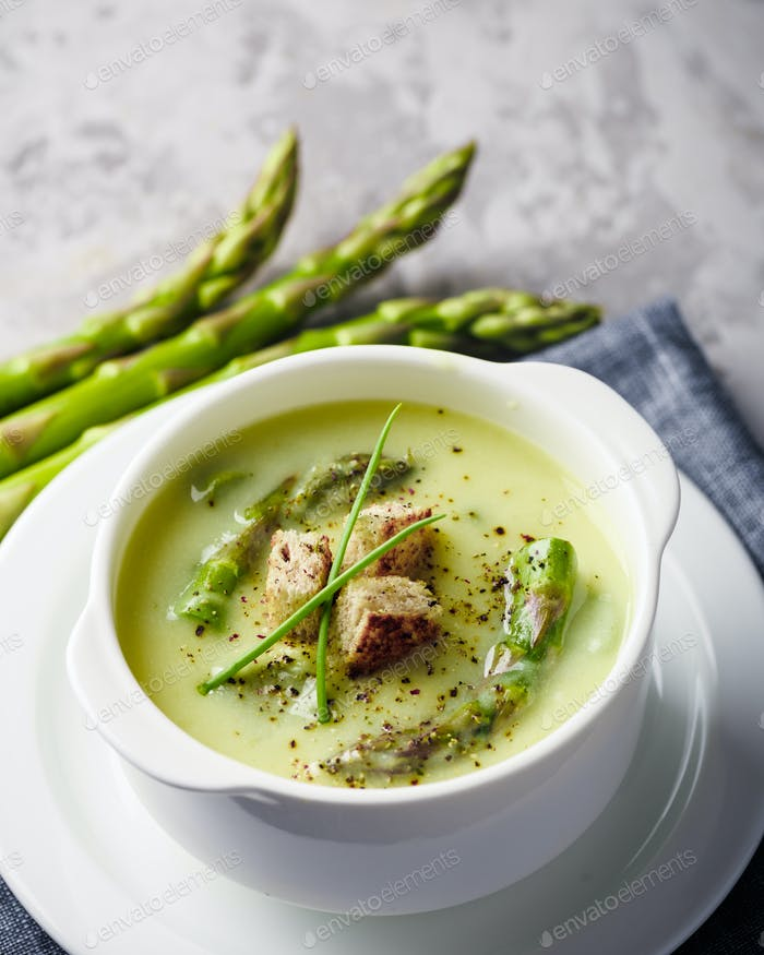 Asparagus soup in white bowl