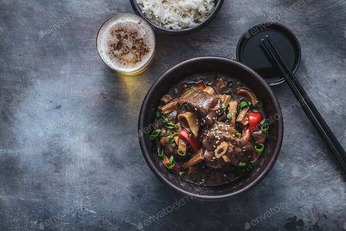 Asian lamb stew in a pot, top view copy space