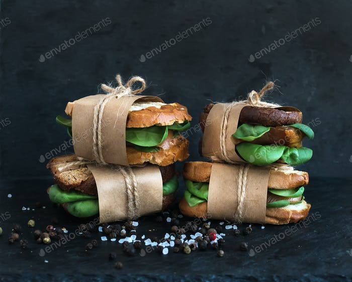 Cured chicken and spinach whole grain sandwiches placed one on a