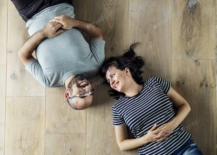 Family lying on wooden floor