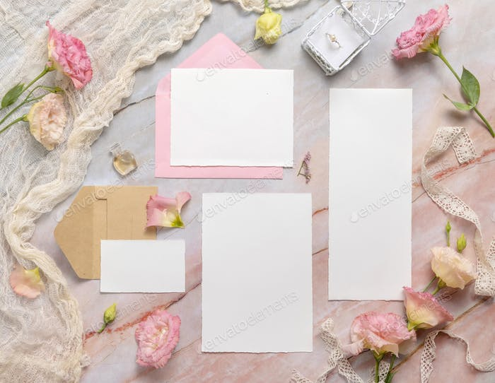 Wedding Wedding stationery set with envelope laying on a marble table
