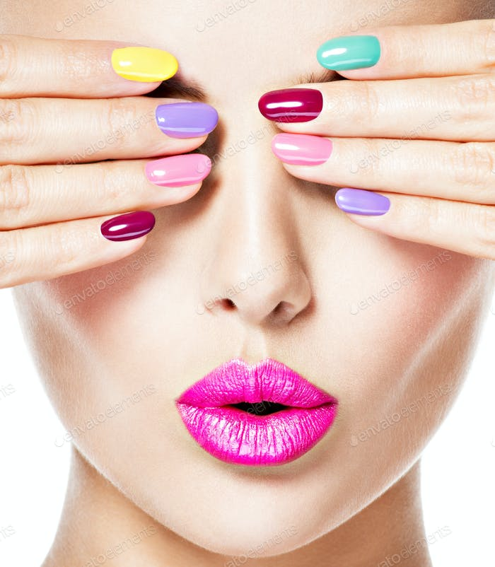 woman  with colored nails and pink lips