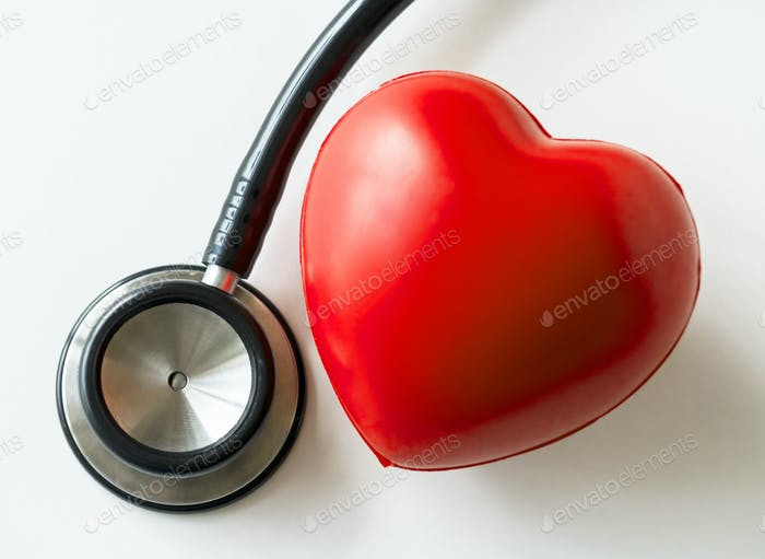 Closeup of heart and a stethoscope cardiovascular checkup concept
