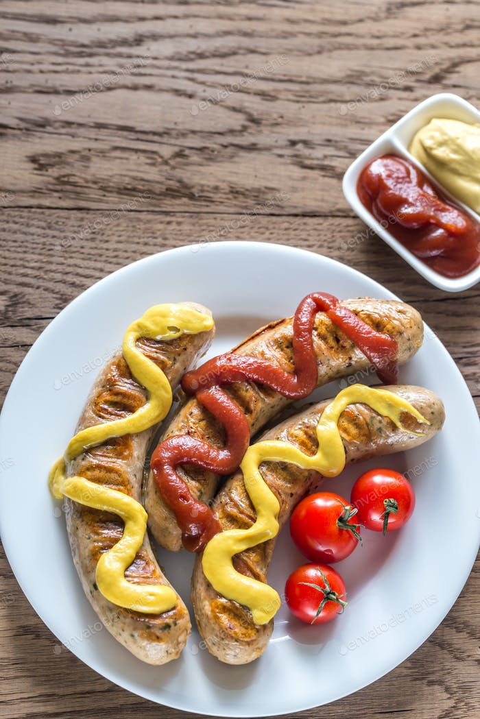 Grilled sausages with tomato and mustard sauce