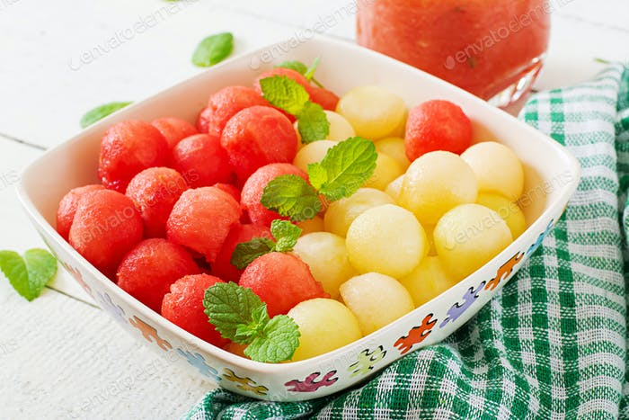 Colorful fruit salad. Watermelon and melon salad. Fresh summer food.
