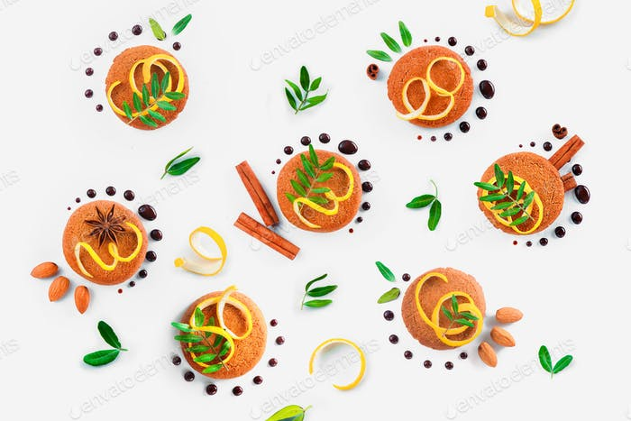 Food styling tips pattern made of cookies, chocolate swooshes and rings, cinnamon, lemon zest and