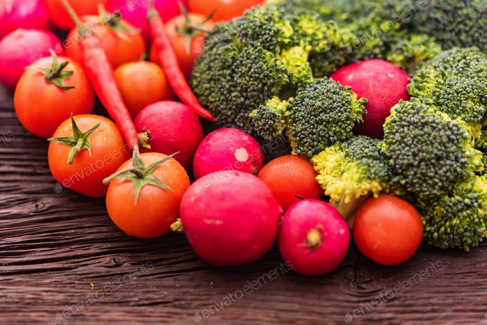 Fresh seasonal vegetables on wooden surface
