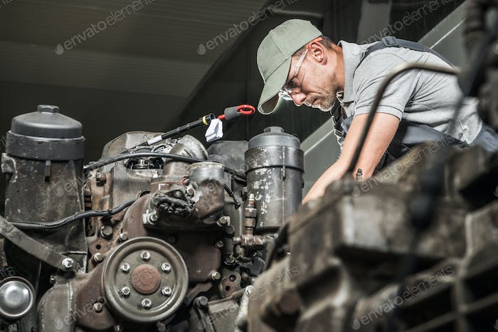 Automotive Technician Restoring Truck Engine