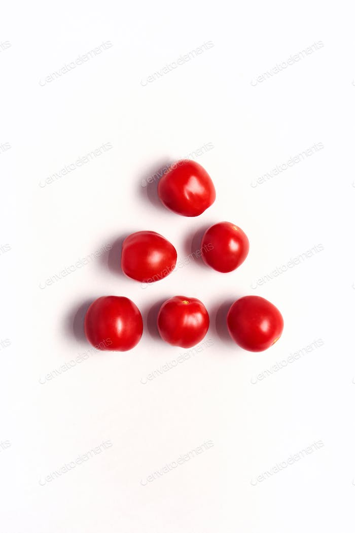 Overhead View Of Individual Fresh Tomatoes On White Background In Pyramid Shape