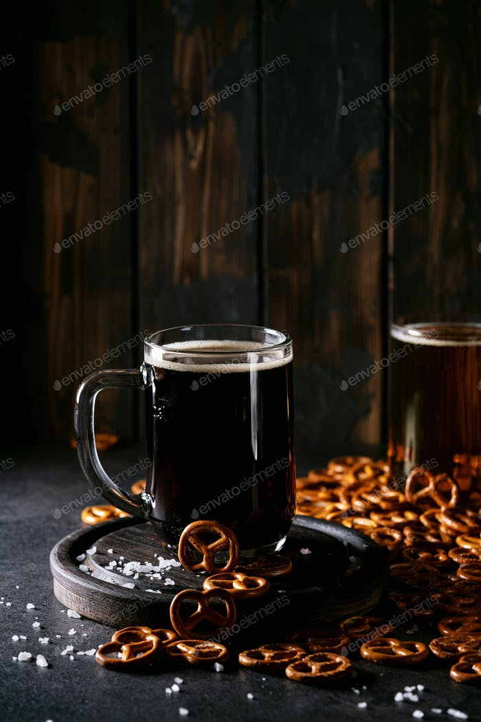 Light and dark craft beer in glass mugs