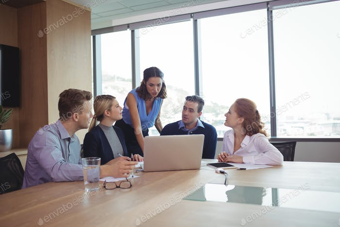 Business people discussing during metting in board room